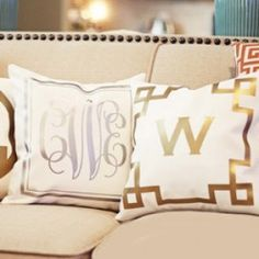 "Our glamorous, metallic monogrammed 14""x14"" throw pillow covers are just beautiful! Add instant glam to any decor. Metallic fabrics are HOT and trendy. Choose gold or silver monogram and border. Pillow cover is made of durable, natural white poly duck canvas with slot opening in back. Sold as the cover only or add the 14"" x 14"" 100% down feather pillow insert. Monogram is not embroidered; monograms are imprinted permanently onto the fabric. Hand wash; dry flat."