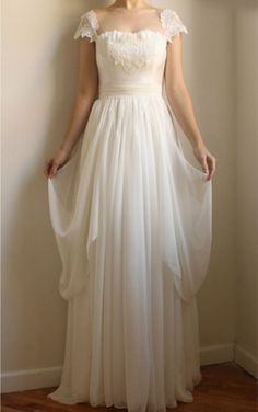 Cap sleeve #weddingdresses help to cover the top part of the shoulder.  This open neckline bridal gown has a flowing chiffon skirt.  Our #fashion firm can recreate this style of bridal dress for you with ease.  When having your gown made to order we can make any change to the design you want.  See other #designerweddingdresses at http://www.dariuscordell.com
