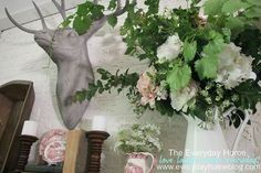 Creating a mantel with a Summer look and feel can be quick and easy. A…