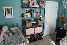 storage and her wrought iron crib