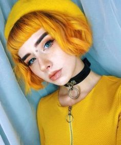 Butterbeer hair is an actual trend that has hit the world of bright hair dye colors. This orange-yellow hue is a bold alternative to traditional blonde locks. If you're down to stand out with hair named after a treat from Harry Potter, this color may be for you. Her blunt bang and super short bob look awesome in this shade of yellow.