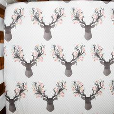 Corner shot of our stag in pink crib sheet. This fabric is so cute and would be perfect in a rustic or.boho themed nursery!