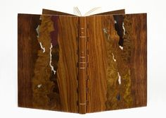 Alain Taral // bound for 2008 ARA-Canada exhibition // bound in pink rosewood, inlaid with many exotic woods, white titling on spine