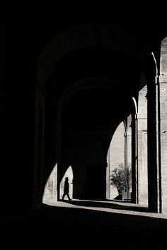 "Matteo Mora....""Intriging ever moving light played through arches on an open exterior walkway"""