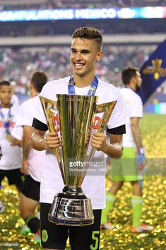 8a019e32e Diego Reyes  5 of Mexico with The CONCACAF Gold Cup Trophy during the  celebrations after