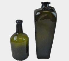 Two 18th C. Black Glass Spirit Bottles : Lot 75  www.JJamesAuctions.com