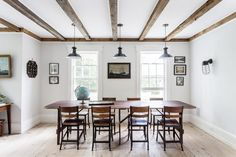 Interior designer Elizabeth Cooper found this dining table and vintage school chairs at the Brimfield Antique Show. On the wall, a ship's lantern from Nova Scotia adds historic atmosphere. | Lonny.com