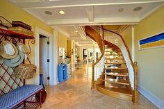 Key West custom wooden staircase winds and swirls from the first floor to the roof-top widows walk for an amazing view. http://vacationhomesofkeywest.com/ultimate-key-west-beach-house---sunset-key-~-vip.html
