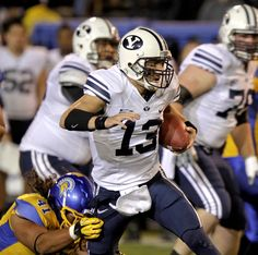 Brigham Young quarterback Riley Nelson breaks a tackle. (AP Photo/John Storey)