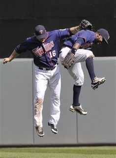 Minnesota Twins left fielder Josh Willingham, left, and center fielder Denard Span celebrate their victory in a baseball game on Thursday, April 12, 2012, in Minneapolis where the Twins defeated the Los Angeles Angels 10-9. Willingham had a solo home run in the game.