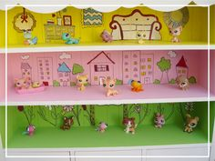 This idea for storing and playing with Littlest Pet Shop guys is BRILLIANT!  I love it.  And think some Squinkies might want to live there too.