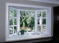 Here's a beautiful bow window idea.  The oversized grids in the side casement windows are complemented by the smaller grid atop the middle picture window.  The space in front of the window serves as a base for decor in this photo, but it could just as easily become a window seat.  For great #ReplacementWindows in Minneapolis MN, contact us - http://www.replacementwindowsmpls.com/