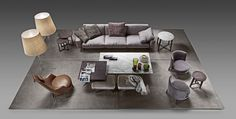 A Flexform Livingroom! In this layout we see a Soft Dream sofa in front of a cluster of Fly coffee tables, surrounded by a pair of Feel Good armchairs and a leather Guscioalto. #Flexform #flexformny #newyork #livingroom  #furniture #luxuryfurniture #sectional #sofa #armchair #coffeetable  #interior #interiordesign #design #industrialdesign #home #decor #homedecor #couch #apartment #luxury #chic #ottomans #footrest #poof