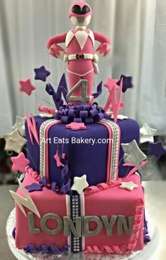 Pink, purple and white fondant square girl's custom creative birthday cake design with bling ribbon, edible stars and power ranger topper. #bakery #cake #pastry #taylors #cupcake #yeahthatgreenville #eatthatgreenville #birthday #birthdaycake #greatupstate #brownies #clemson #fowersrangers