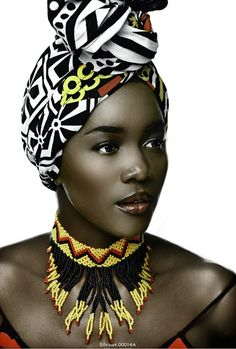 Stunning model lets her gorgeous face show as she wraps her hair in colorful fabric.