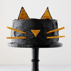 Black Cat Cake! Celebrate Halloween with this adorable cat cake with a simple silhouette face and gold glitter cat ears!