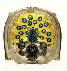 Sconce, steel, bronze, silver, brass and enamel, English, ca.1899, designed and made by Alexander Fisher.. Museum Number M.24-1970