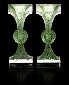 René Lalique 'Rameaux' a Pair of Candlesticks, design 1934 frosted glass, heightened with green staining 20cm high