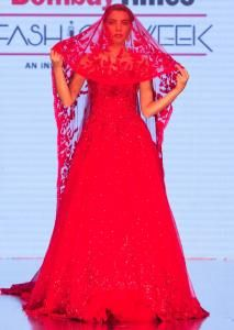 c46be20820d5 Ruby red gown with a long head trail with pleated net border only on kalki