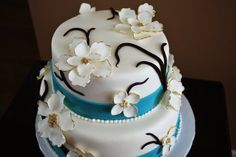 Elegant Wedding Cake with Blue and Gold Accents and Fantasy Flowers