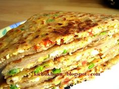 Egg Bhurji stuffed Paratha 2 eggs beaten, 1 small onion chopped, 1 green chilli chopped, veggies of you choice( I used finely chopped carrots and tomatoes and some green peas, salt to taste 1 tsp cooking oil. And of course kneaded atta.