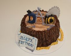 "Happy Birthday for the Woodworker - Woodworkers cake.  The ""bark"" is modeling chocolate chunks, the grain ring piece was made from fondant.  All the tools, nails, and blueprints were made from fondant as well."