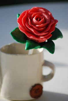 Red Rose Cake Pop by Kiss And Bake Up, via Flickr
