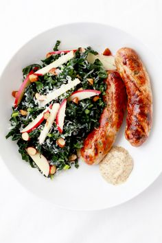 Grilled Chicken Sausages with Shredded Kale, Apple, and Hazelnut Salad #recipe