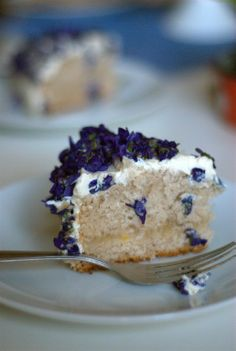 vegan lemon cake with cream uncheese frosting and fresh violets