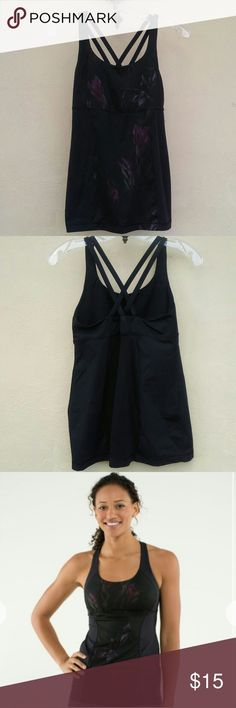 Lululemon energy tank in midnight iris Missing bra cups and size is unknown (Believe me I looked). I do know it's bigger than a 6.Price reflects defect. Contact me if you have any questions. lululemon athletica Tops Tank Tops