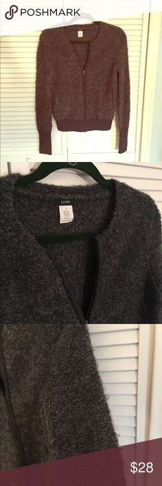 🆕J. Crew Gray pre-loved Fuzzy Zip-Front Sweater. 🆕Gray pre-loved Fuzzy J. Crew Zip-Front Sweater. Size Small. This warm sweater is soft and zips up in front as a cardigan would. It is gently worn, the nature of the wool is a bit prone to pulling as you can see from pics. A very nice warm sweater.  Priced to reflect gently used condition. J. Crew Sweaters Cardigans