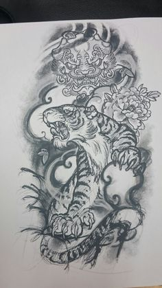 Tiger/foo dog tattoo design. Got on my left arm.