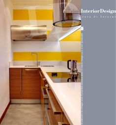 Cucina finitura zebrano e top corian www.studiointeriordesign.it