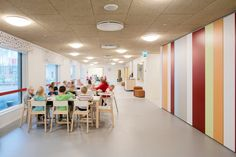 Colourful metal cladding extends across the front of this daycare centre in the Finnish city of Espoo, which encloses a secluded playground School Places, Metal Cladding, School Architecture, Centre, Flooring, Kindergarten, Wraps, Playground, Furniture