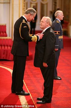 Joe Cocker receiving the OBE Awar from Prince Charles in 2007