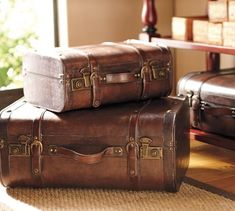 These vintage-style trunks are designed to capture the character of custom luggage crafted in the and Each is made of wood that's hand wrapped with distressed faux leather. Old Luggage, Custom Luggage, Old Trunks, Vintage Trunks, Antique Trunks, Vintage Suitcases, Vintage Luggage, Vintage Travel, Leather Suitcase