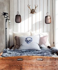 Bohemian Scandinavian painted wood paneling, colors, and accessories.