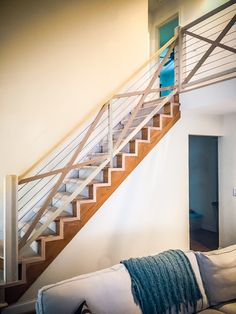 Beautiful straight wooden staircase with a cable railing system for a residential space. Staircase Railings, Wooden Staircases, Stairways, Cable Railing Systems, Wrought Iron, Contemporary, Modern, Interior And Exterior, Cabin