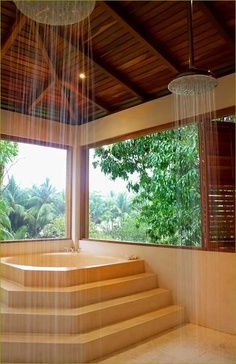 Large master bathroom with twin rainfall showers and unusual soaking tub overlooking the jungle gardens.