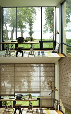 Softly filter harsh light and add an updated classic style to a home office with Alustra® Woven Textures® Roman Shades  ♦ Hunter Douglas window treatments
