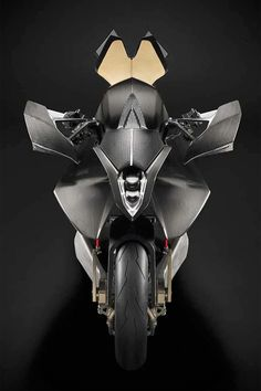 The Vyrus Alyen: a hyperbike with hub-centered steering, powered by a cc version of Ducati's short-stroke Superquadro motor. It's crammed into a magnesium frame, and surrounded by bodywork that looks to be mostly carbon fiber. Mv Agusta, Ducati, Gear Pump, Motorcycle Camping, Engine Types, Moto Guzzi, Bike Design, Custom Bikes, Carbon Fiber
