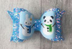 Bunny snowman bow, panda snowman bow, blue glitter bow, christmas bow by HappyBowBeautiful on Etsy https://www.etsy.com/uk/listing/548063306/bunny-snowman-bow-panda-snowman-bow-blue