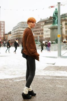 On the Street….Skate, Stockholm « The Sartorialist_ The gathered back of the jacket with the belt+leg warmers on wedges+skin fit pants