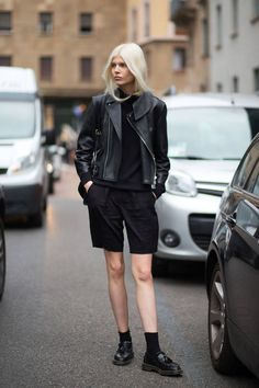 Ola Rudnicka knows a leather biker jacket lends the perfect amount of cool to basic black.   - HarpersBAZAAR.com