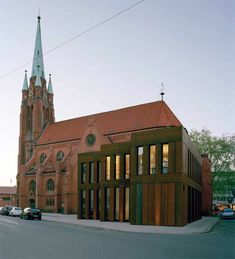 Really like the shape of this building though I'm not entirely sure about the material. Extension to the Apostelkirche in Hanover, 2013 by Pax Brüning Architekten. Photo by Klemens Ortmeyer.