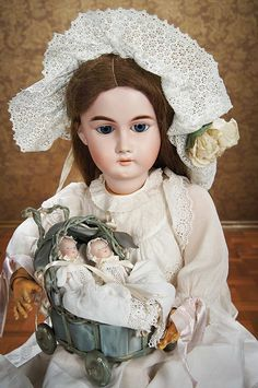 "Rare Large German Bisque Child Doll by Kling with Bell Symbol 32"" (81 cm.) Marks 370-15K (in bell) Circa 1890 with 4"" Bye Lo babies in fancy carriage"