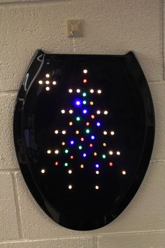 #1 - Black toilet seat wreath with LED lights