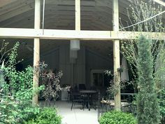Backside of the covered patio...open on the front, covered in lights, but still with a roof.