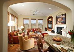 SUZANNE MYERS ELITE INTERIOR DESIGN: Cozy family room upholstered in bourbon-colored leather. Windows covered in woven wood Conrad shades.