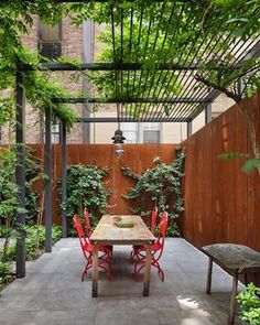 Stunning Revival of a NYC Townhouse by O'Neill Rose Architects The outdoor space is anchored by a custom steel trellis.The outdoor space is anchored by a custom steel trellis. Wooden Pergola, Outdoor Pergola, Backyard Patio, Backyard Landscaping, Backyard Ideas, Patio Ideas, Metal Pergola, Garden Ideas, Landscaping Ideas